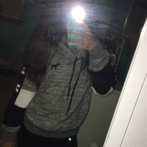 Grey, black, and white sweatshirt from pink